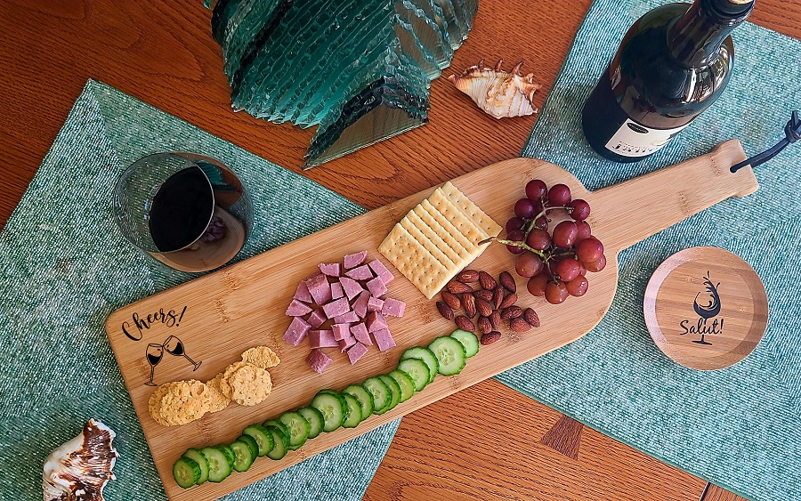 An engraved wine bottle charcuterie board can help elevate your next wine party to the next level with a beautiful design. Personalized Cheese Board with Handles | Personalized Charcuterie Board | Ways to Make a Charcuterie Board | What to Put on a Charcuterie Board | Engraved Gifts for Wine Lovers | Custom Cheese Board with Logo #wineparty #charcuterieboard via @thebestoflife